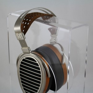 Headphone stand in clear finish, shown with HifiMan HE1000